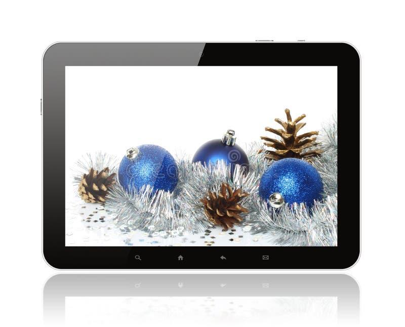 PC della compressa con la decorazione di Natale fotografia stock libera da diritti