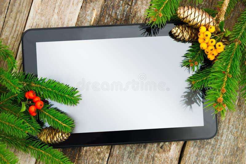 PC della compressa con la decorazione di Natale immagine stock