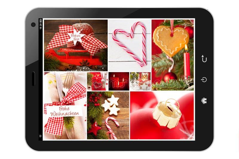 Pc della compressa con le immagini di natale fotografie stock