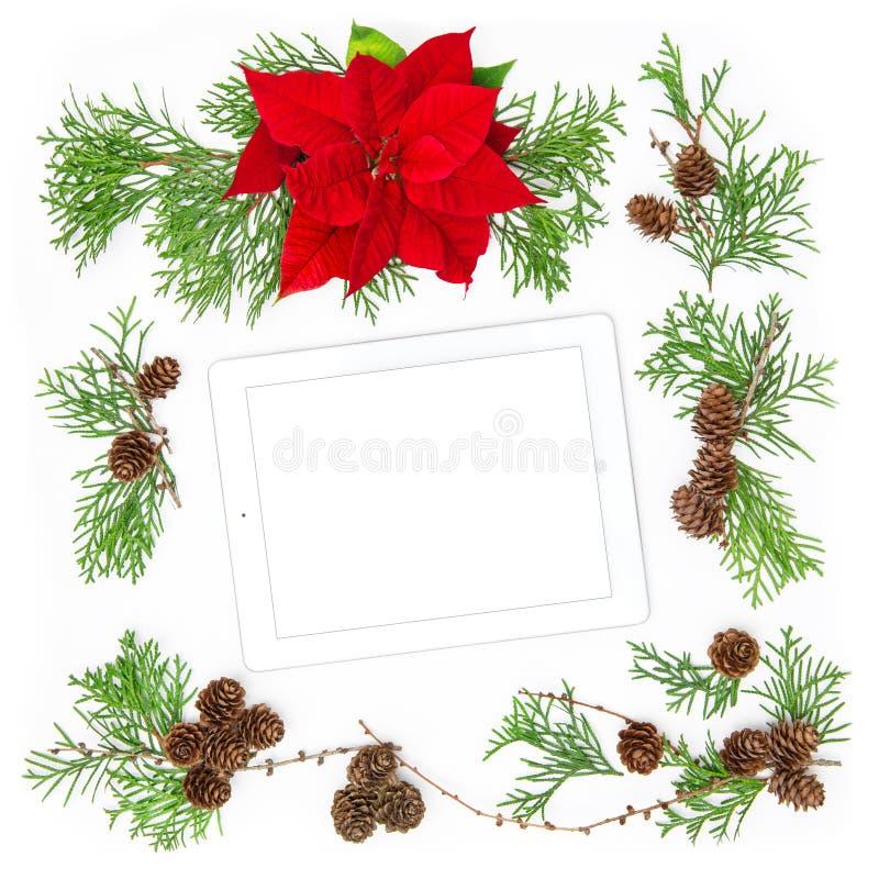 Pc della compressa e decorazione di Natale Fondo floreale di disposizione del piano immagini stock