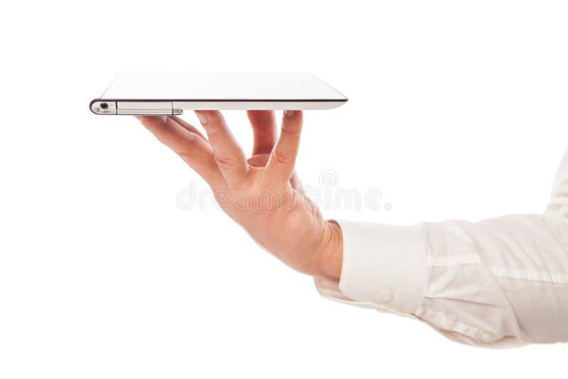 Pc maschio del touchpad della tenuta della mano isolato fotografia stock libera da diritti
