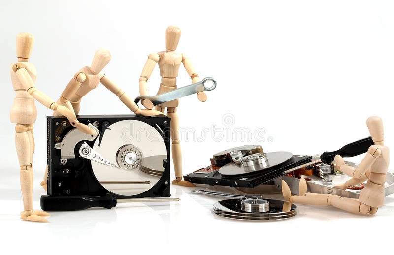PC repair. Wooden puppets with hardware on white background royalty free stock image