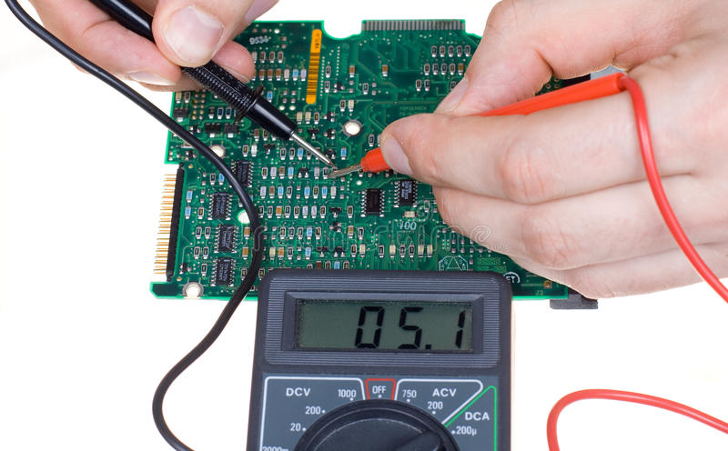 PCB diagnostics and measurement. By means of a multimeter royalty free stock image