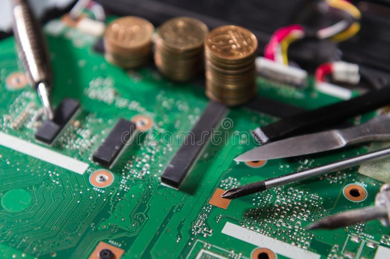 PCB Green With Tools And Coins, A Screwdriver, A Soldering Iron ...