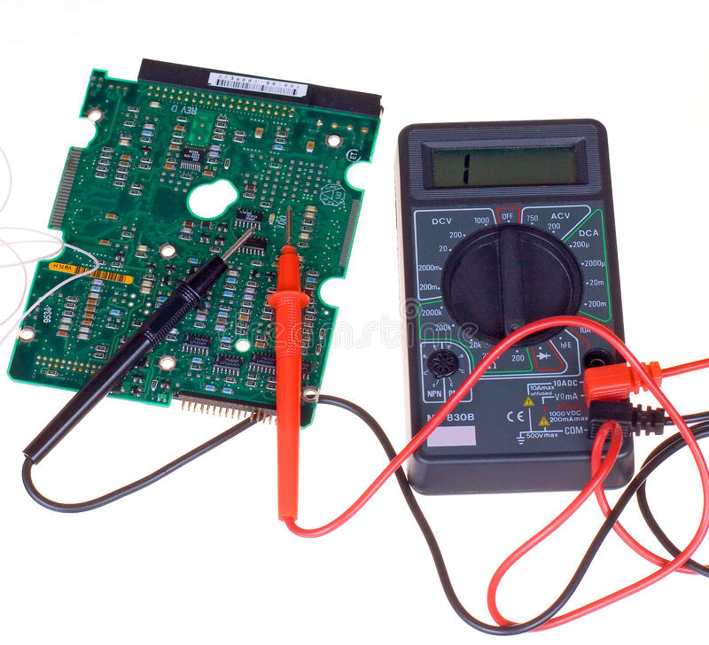 PCB and multimeter. Printed circuit board and multimeter royalty free stock images
