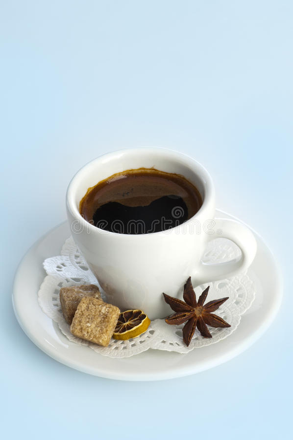 Pcup of coffee with brown sugar and anise star. Cup of coffee with brown sugar and anise star stock image