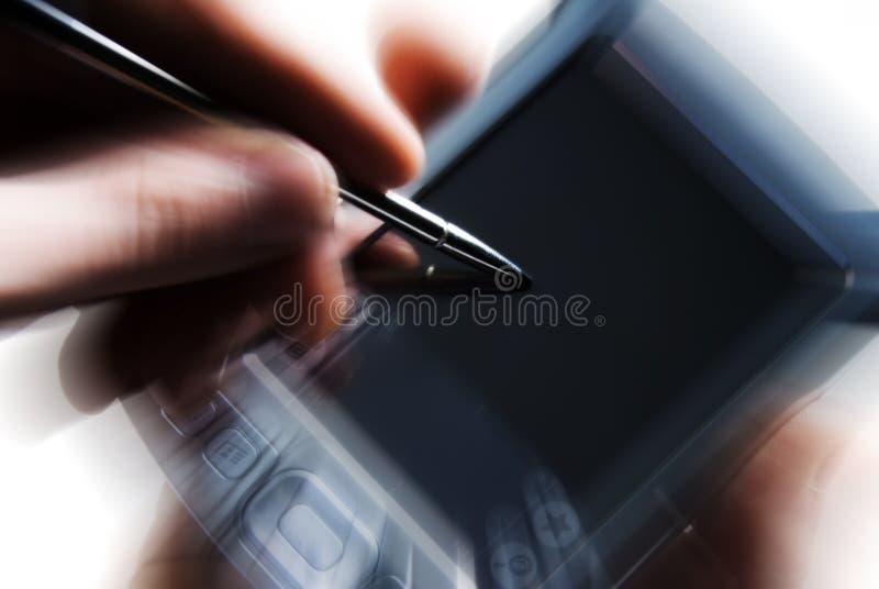 PDA avec la tache floue de mouvement photo stock