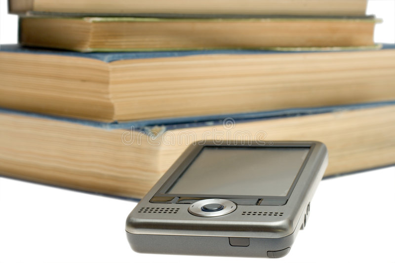 PDA and books royalty free stock photography