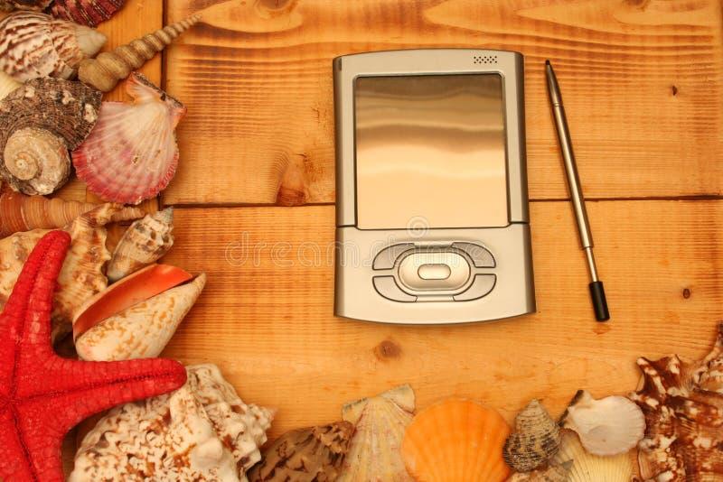 PDA con los shelles fotografía de archivo