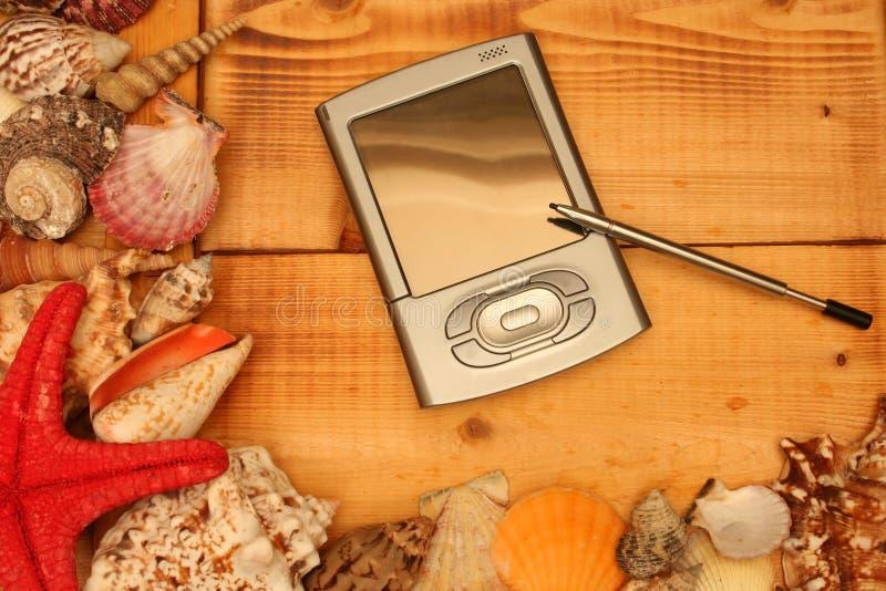 PDA en la madera fotografía de archivo