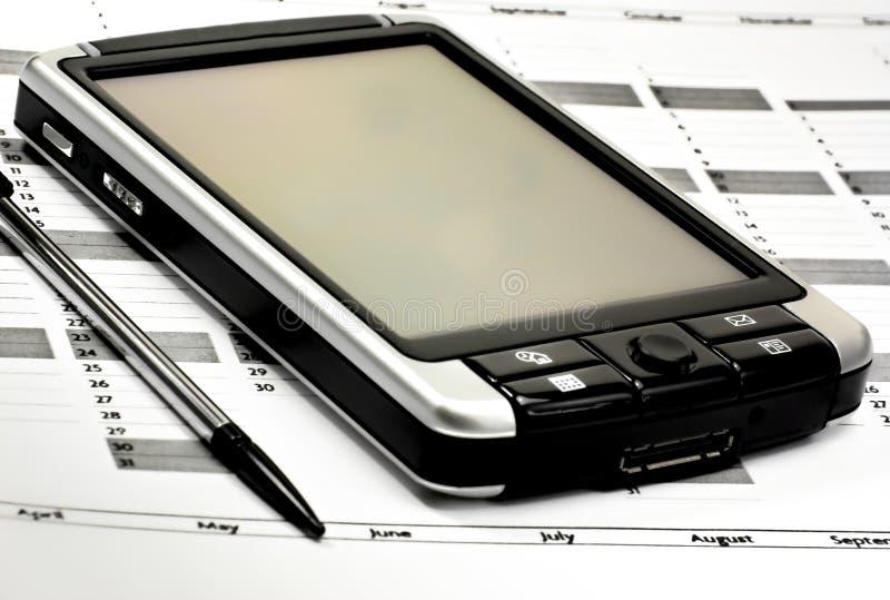 PDA en planificador foto de archivo libre de regalías