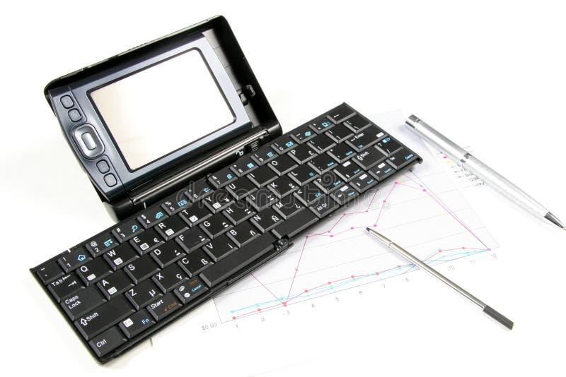 PDA et clavier sur le fond blanc photo libre de droits