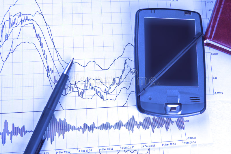 PDA And Pen On Stock Chart Stock Images