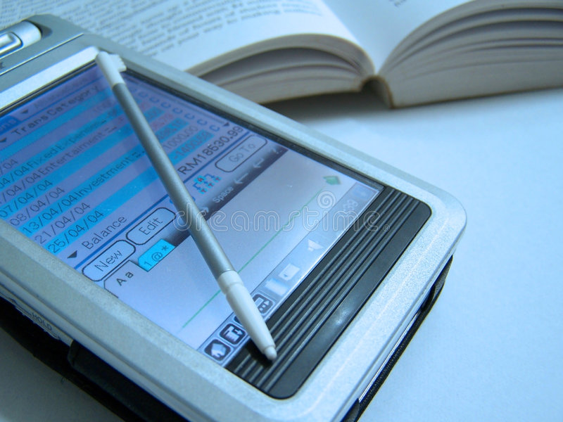 PDA u. Buch lizenzfreies stockbild