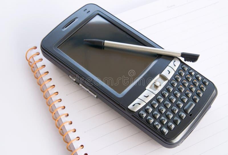 PDA y libreta foto de archivo libre de regalías