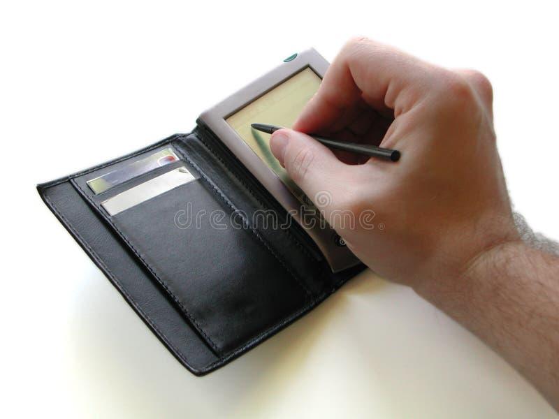PDA y mano fotos de archivo libres de regalías