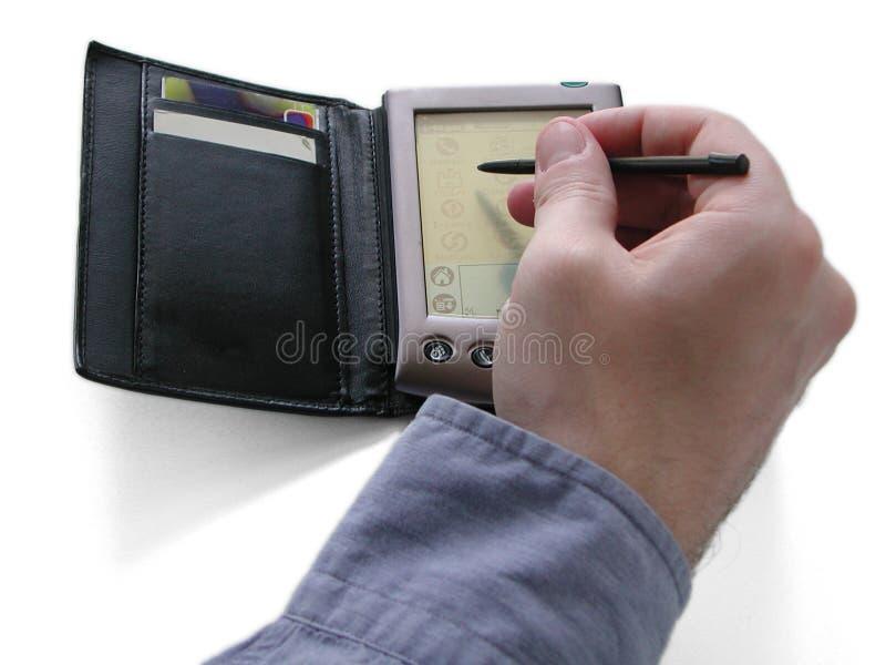 PDA Y Mano Fotografía de archivo libre de regalías