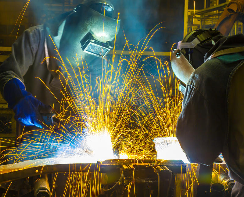 Peça automotivo de Team Welder Industrial fotos de stock