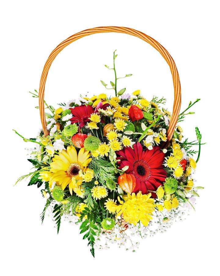 Peça central colorida do arranjo do ramalhete da flor em um presente de vime fotos de stock royalty free