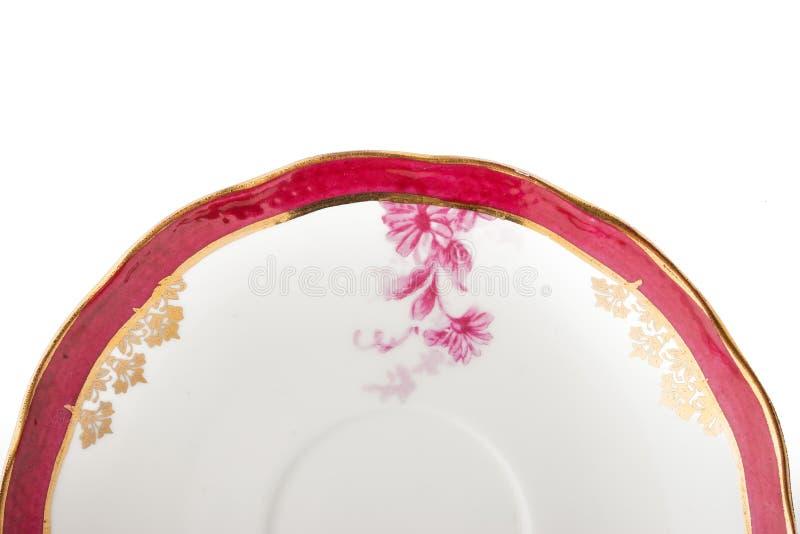 Peça da placa da porcelana do vintage no fundo branco foto de stock