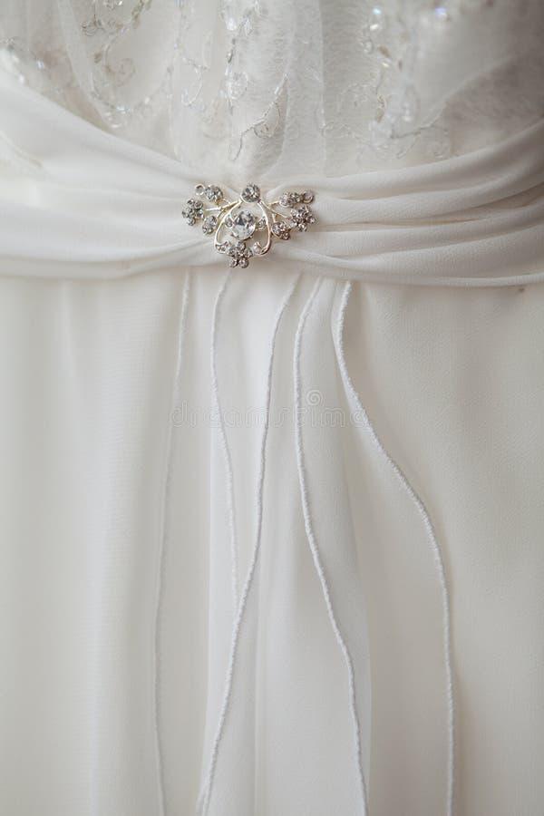 Peça de um vestido com brooch imagens de stock