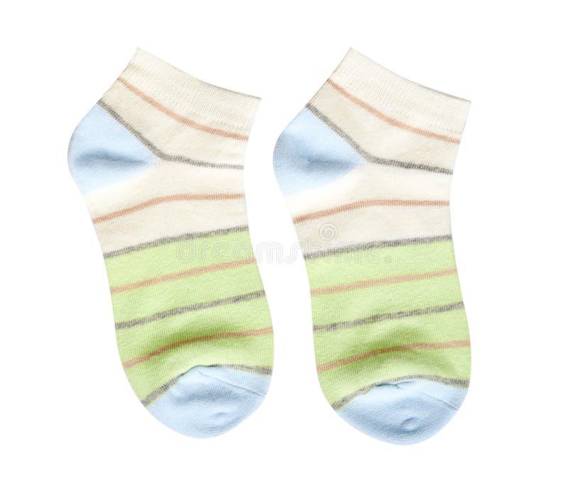Peúga listrada do algodão, calçados da criança Fundo isolado imagem de stock