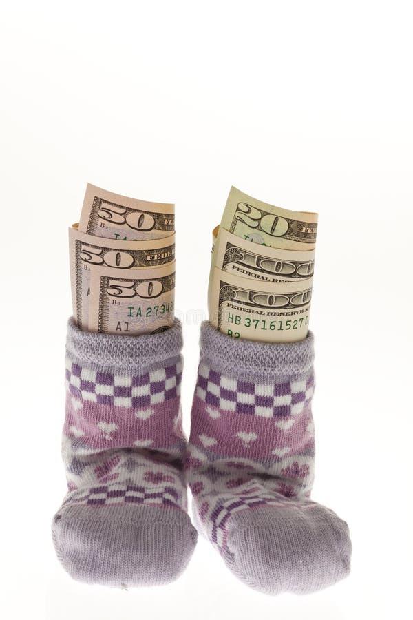 Peúgas Das Crianças Com Contas De Dólar Fotografia de Stock