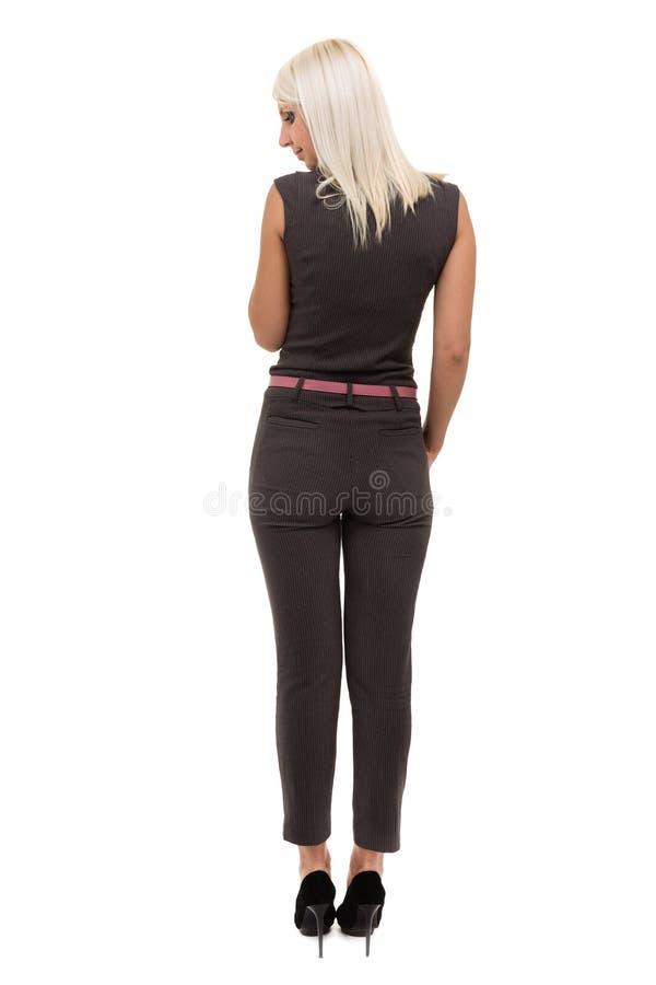 Pełna długość piękna młoda kobieta w całkowitej pozyci nad bielem zdjęcia stock