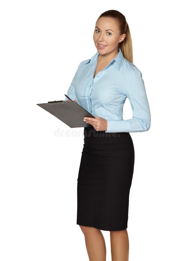 Pełna długość robi notatkom uśmiechnięta kobieta obrazy stock