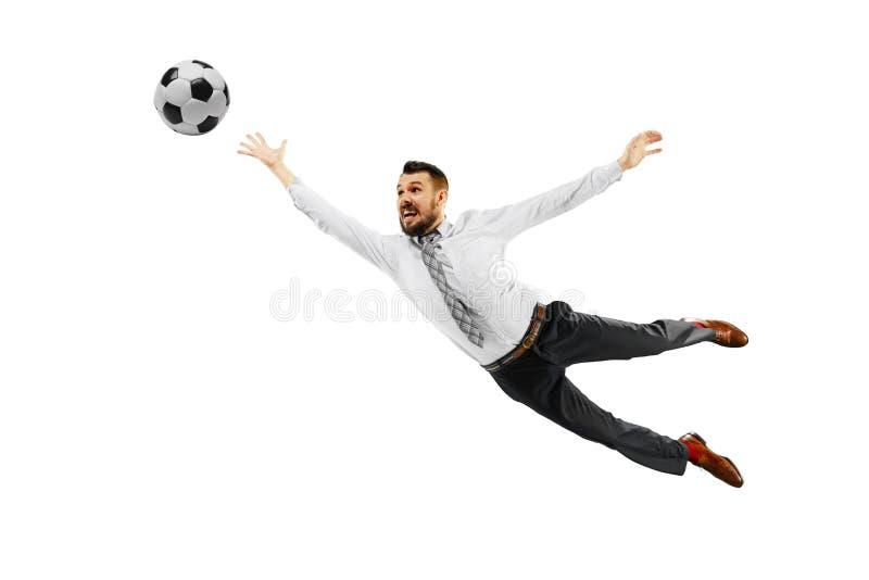 Pełna długość strzelał młody biznesmen bawić się futbol odizolowywającego na białym tle fotografia stock