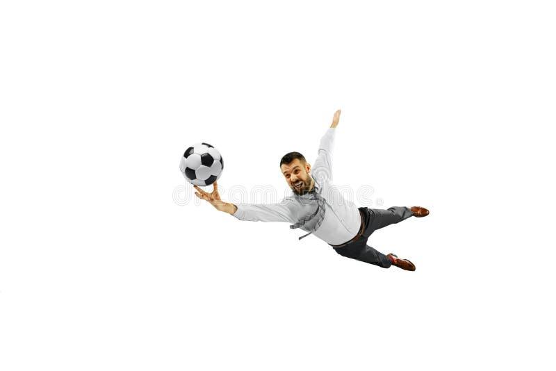 Pełna długość strzelał młody biznesmen bawić się futbol odizolowywającego na białym tle obraz stock