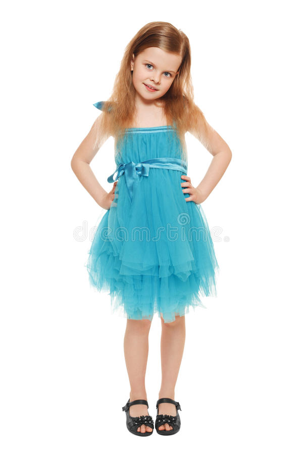 Pełna długość urocza mała dziewczynka w błękit sukni, odosobnionej na białym tle fotografia stock