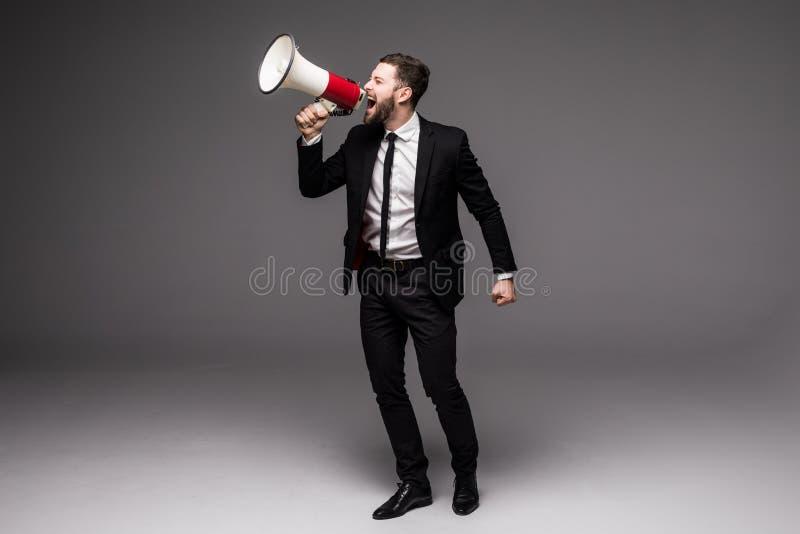 Pełnego wzrosta Biznesowy mężczyzna krzyczy z megafonem fotografia stock