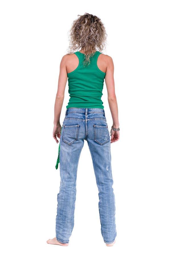 Pełny długość obrazek przypadkowa młodej kobiety pozycja zdjęcia stock