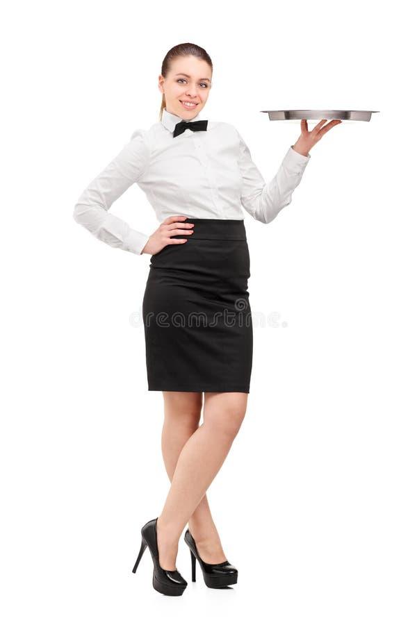 Pełny długość portret kelnerka trzyma pustego z łęku krawatem obraz royalty free