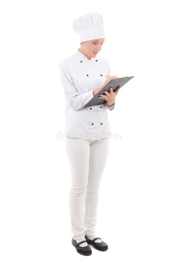 Pełny długość portret młoda kobieta pisze niektóre w szefa kuchni mundurze fotografia royalty free