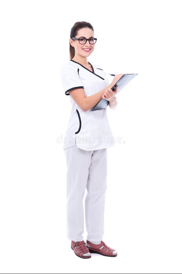Pełny długość portret młody piękny kobiety lekarki writing som fotografia royalty free