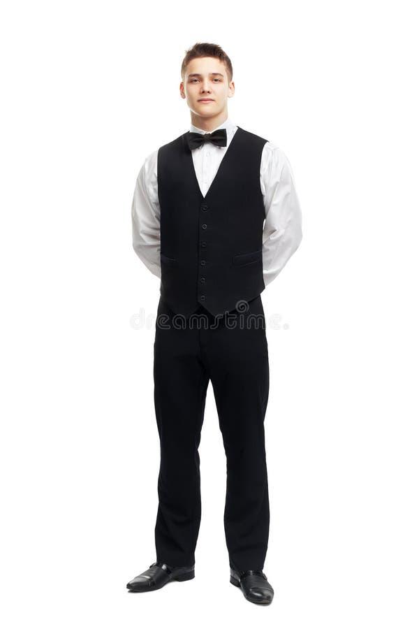 Pełny długość portret młody uśmiechnięty kelner fotografia stock