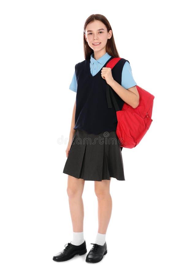 Pełny długość portret nastoletnia dziewczyna w mundurku szkolnym z plecakiem obraz royalty free