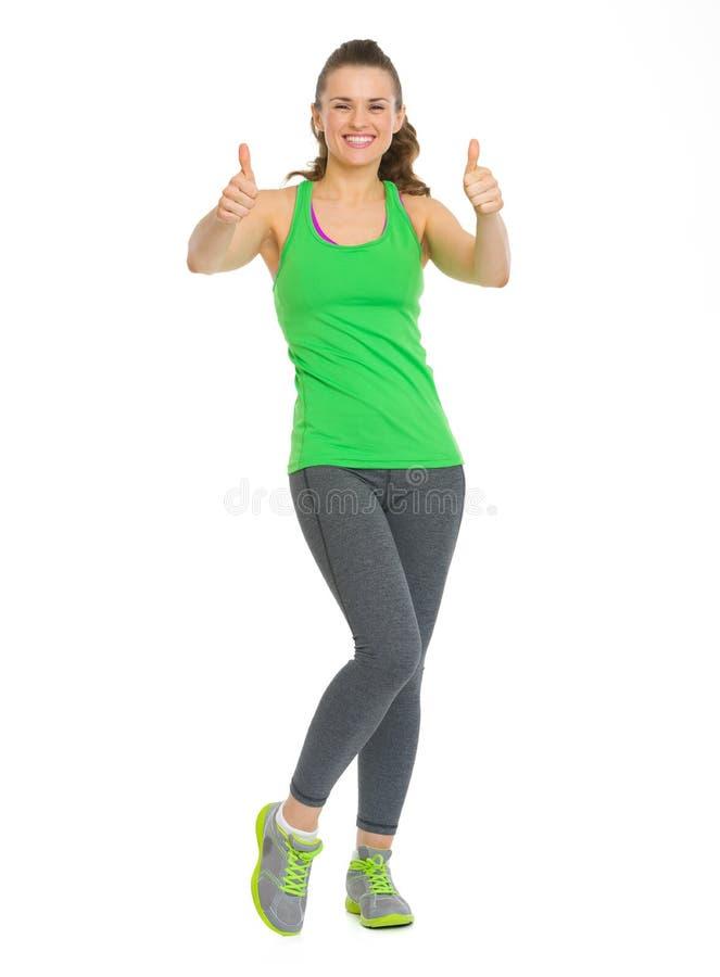 Pełny długość portret szczęśliwa sprawności fizycznej kobieta pokazuje aprobaty obraz stock