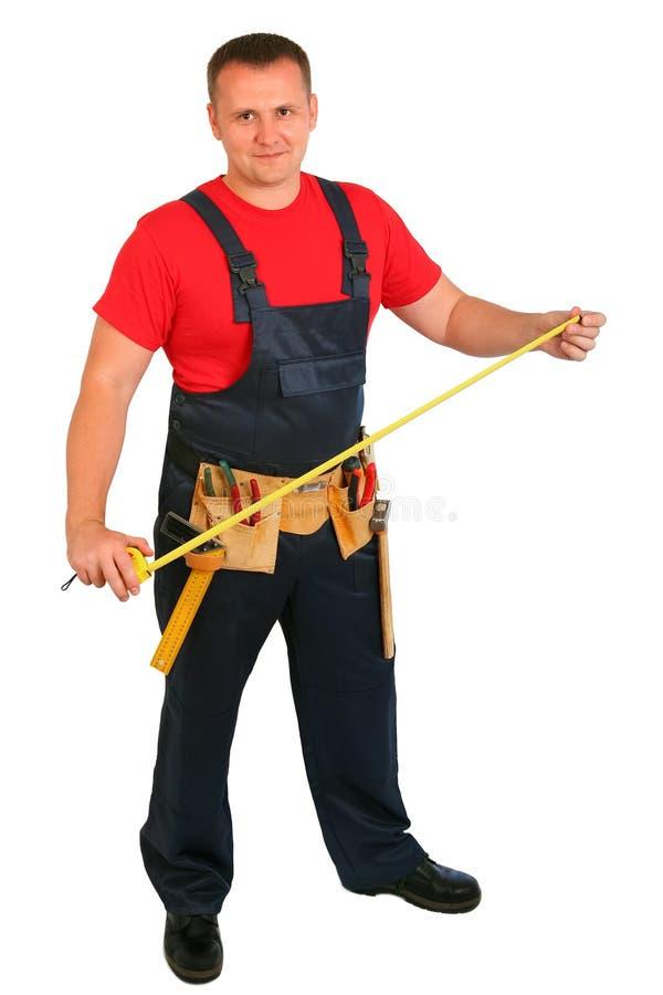 Pełny długość portret szczęśliwy caucasian pracownik budowlany odizolowywający na białym tle Uśmiechnięty przystojny hydraulik Zł zdjęcie royalty free
