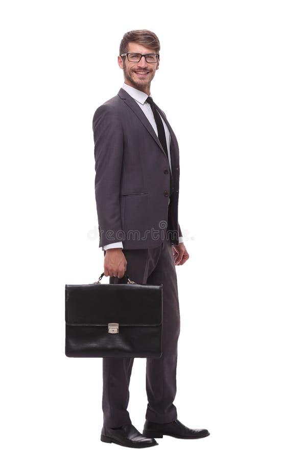pełny przyrost ufny biznesmen z rzemienną teczką zdjęcie stock