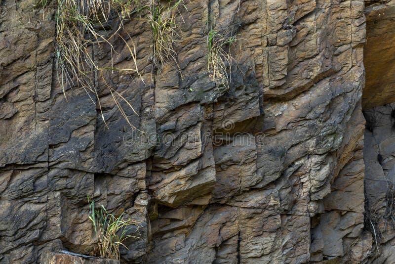 Pe?a de uma parede de pedra, para o fundo ou a textura fotografia de stock royalty free