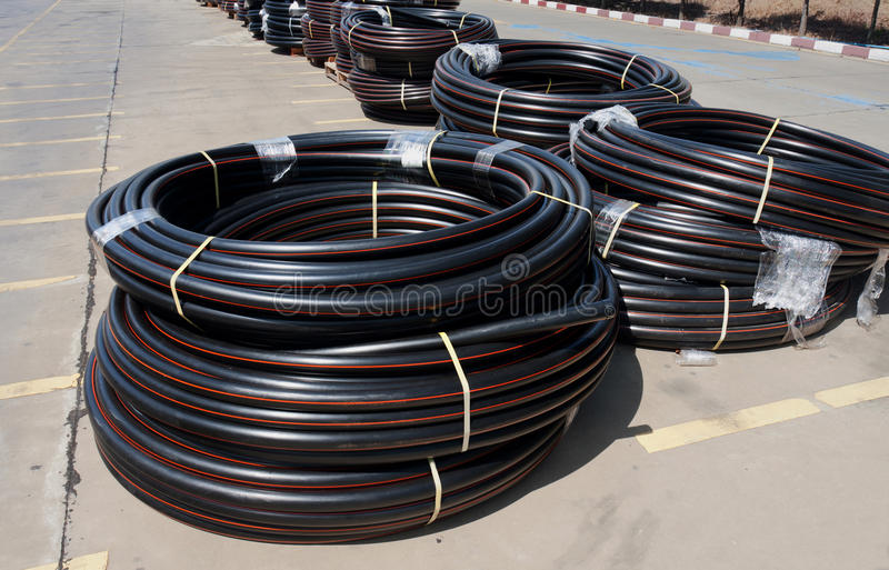 PE pipe rolls. Polyethylene pipe or PE pipe rolls for electricwire and water supply royalty free stock photography