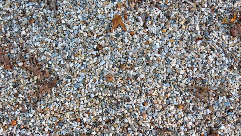 Pea Gravel. Or 3/8 in stone, used for landscaping, driveway base, or,decorative use outside the home; provides some texture to your landscape stock photo