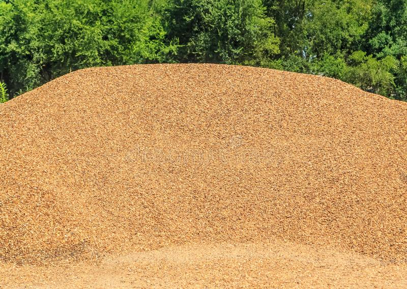 Pea Gravel Mound. Mound or bin of Pea gravel used for landscaping and driveways on display and for sale stock photography