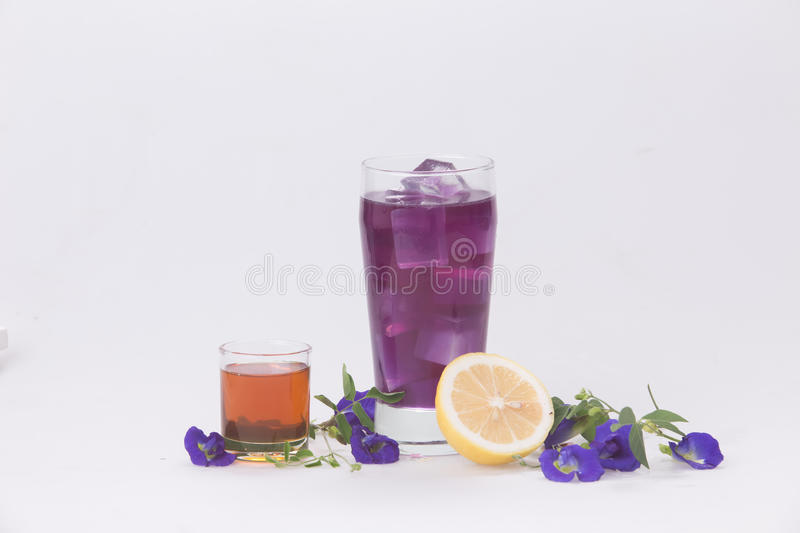 Pea, lemon juice and honey in a glass with ice. Refreshing thirst quencher. Lemon water with honey, herbs, pea Thailand in a glass with ice. Refreshing, thirst stock photos
