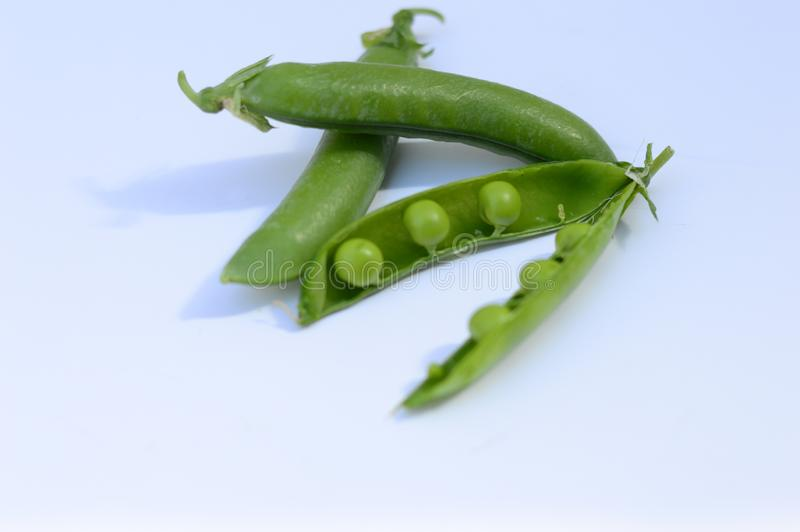 Pea pods and green peas stock photo