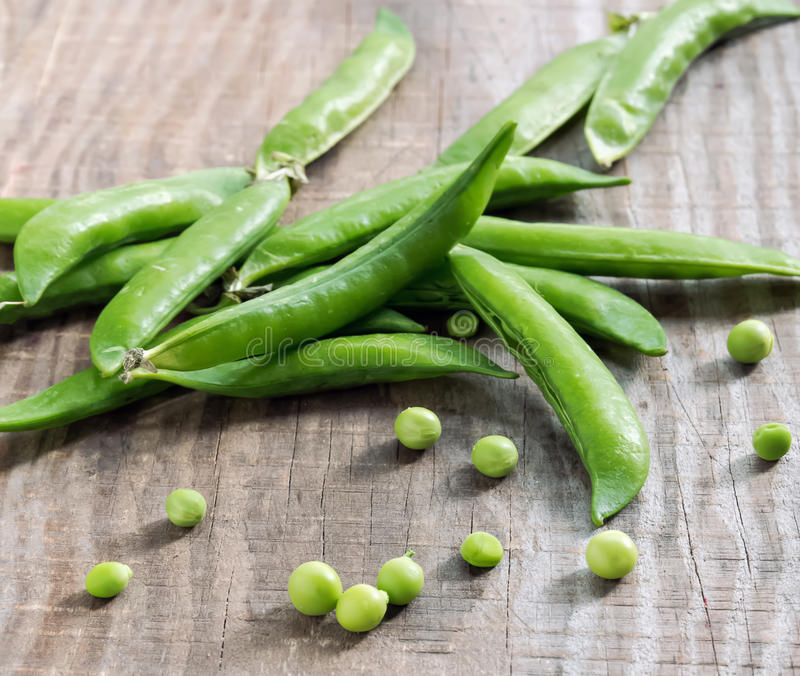 Pea pods on the table royalty free stock photography