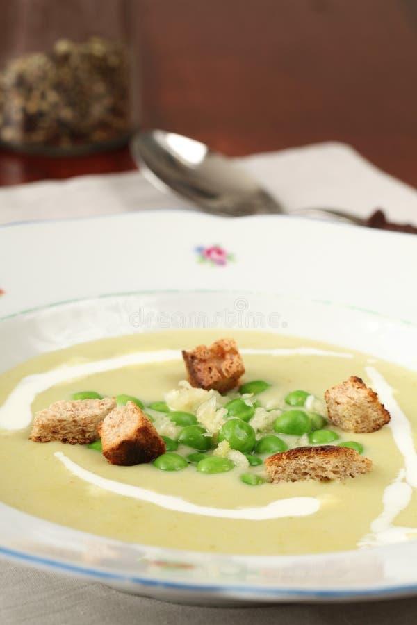 Pea soup with garlic royalty free stock photos